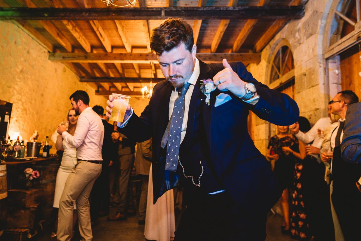 Fun groom dances at french chateau wedding