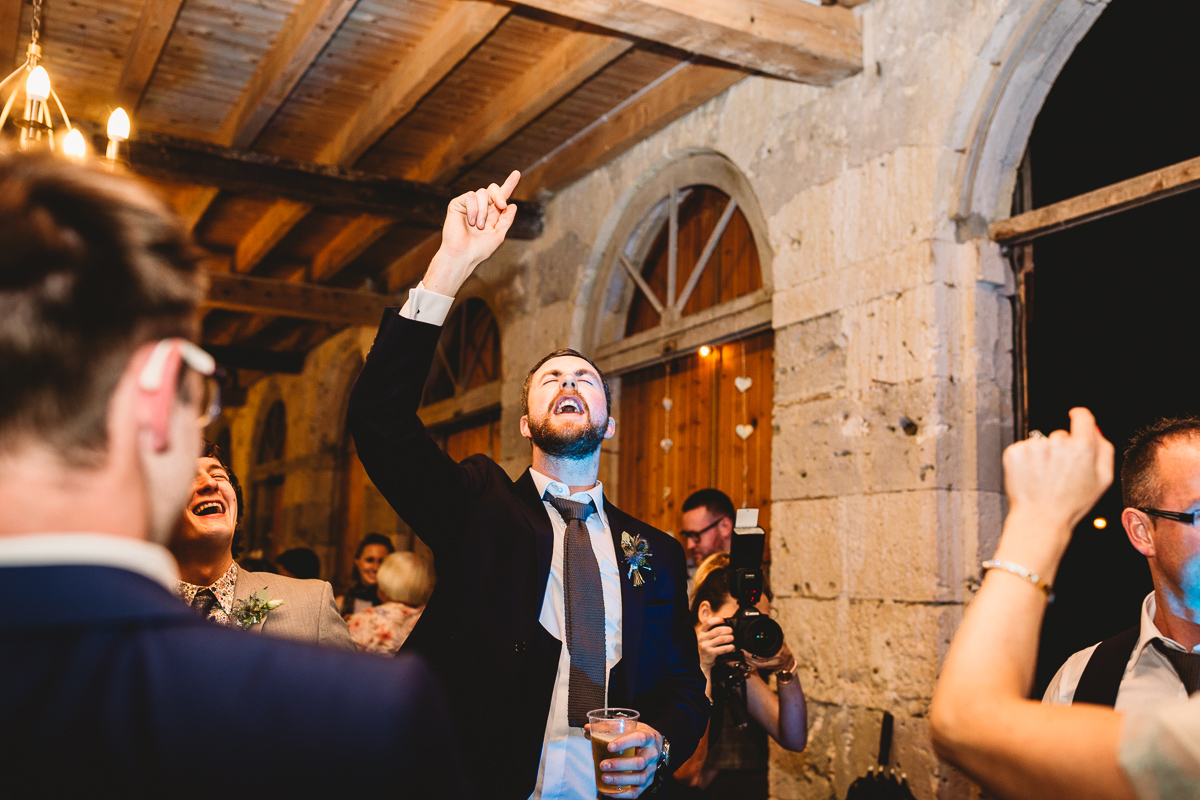 Fun best man dancing at chateau wedding