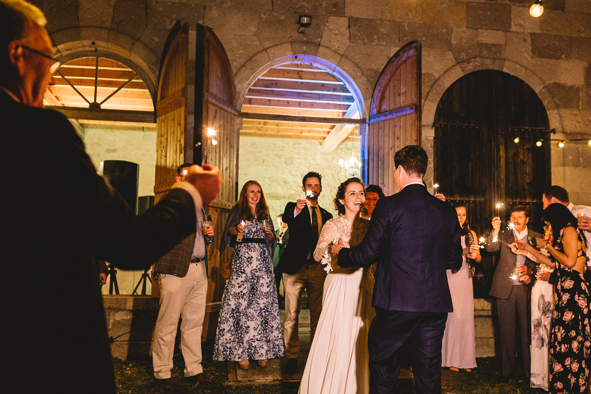 Outdoor wedding in France with a bride in a Rue De Seine dress
