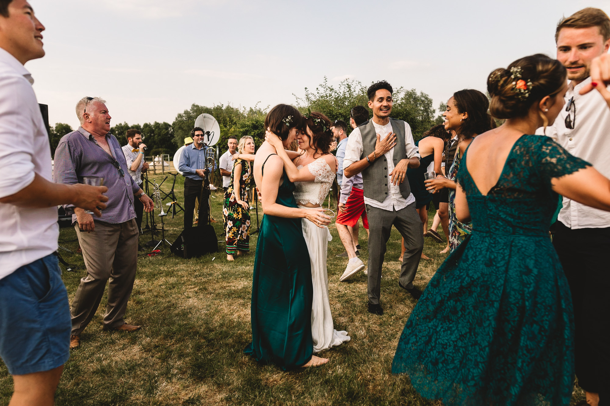 Alternative festival wedding guests dancing outdoors to Jazz band outside of London