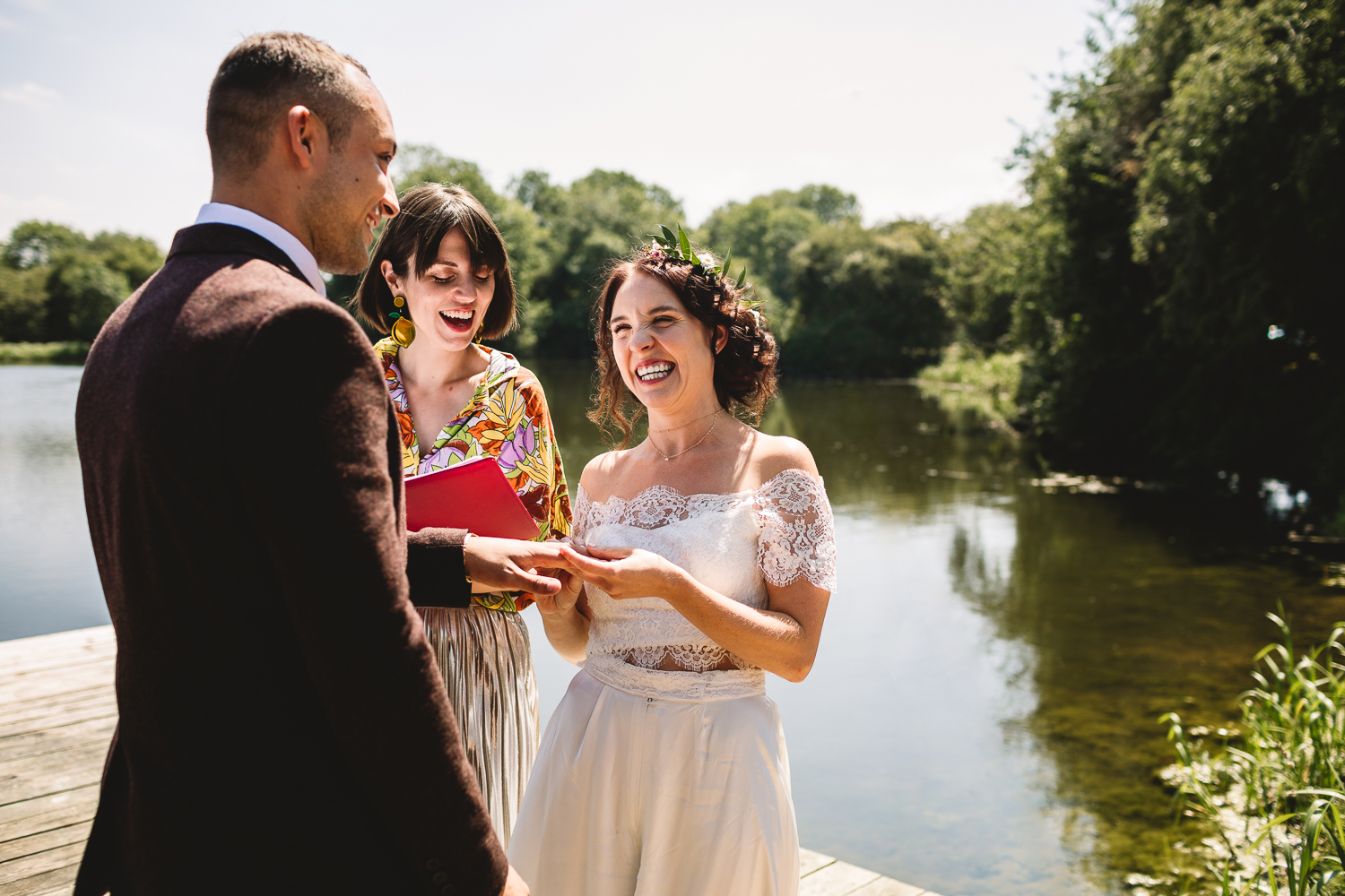 Alternative bride and groom exchanging rings outdoors at fun humanist festival wedding in Shropshire