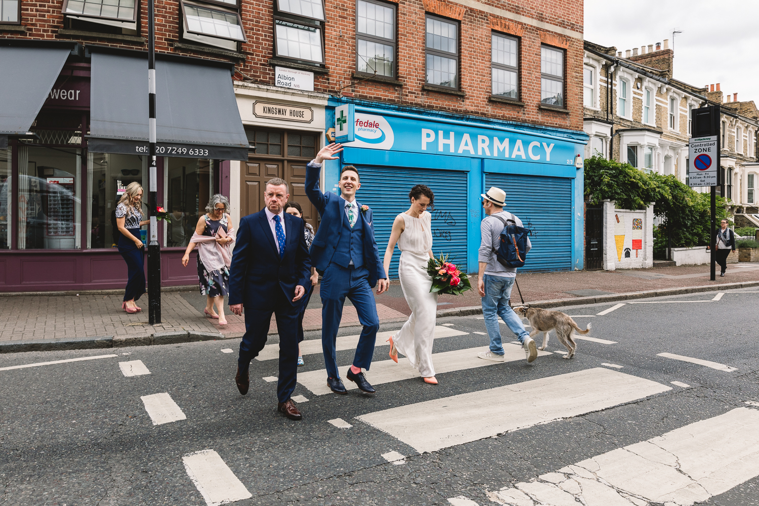 Documentary photo of alternative wedding party crossing a london pedestrian crossing on their way to Stoke Newington Town hall