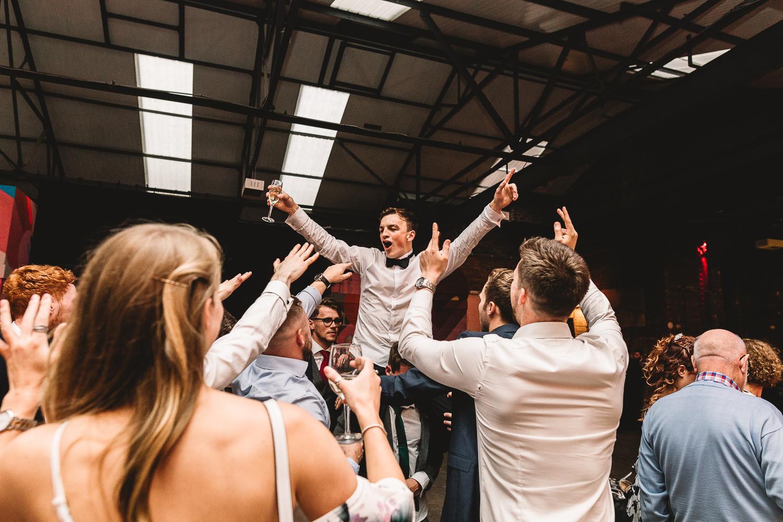 92 Burton Road Wedding Groom is dancing on shoulders of friends and singing