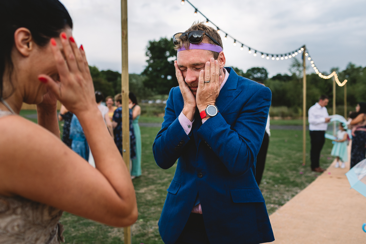 Man with head in hands after loosing to a high five | Fun Wedding Warwickshire & Cotswolds Photographer | Kate Jackson Photography