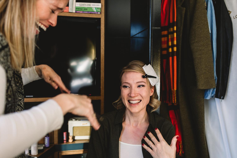 Bride having fun having makeup done at Hoxton Hotel