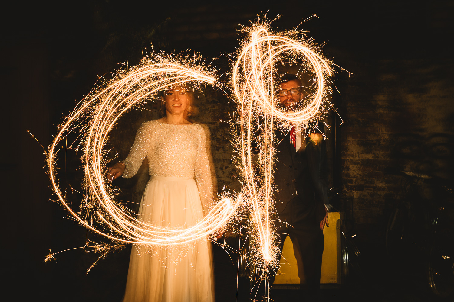 Long exposure couple alternative wedding portrait with sparklers