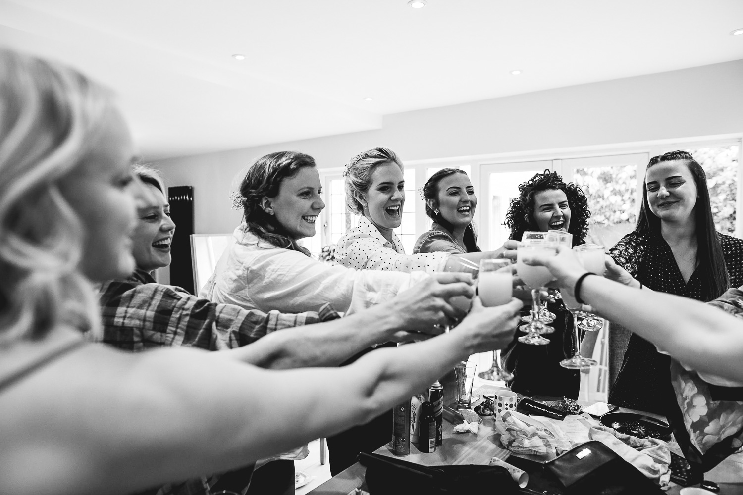 Photo of bridal party cheersing at relaxed Sheffield wedding