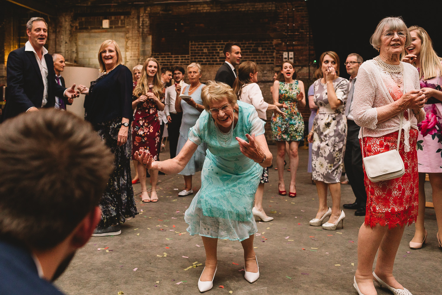 Granny in mint green dress having a boogie at fun wedding party at alternative warehouse wedding venue 92 burton road
