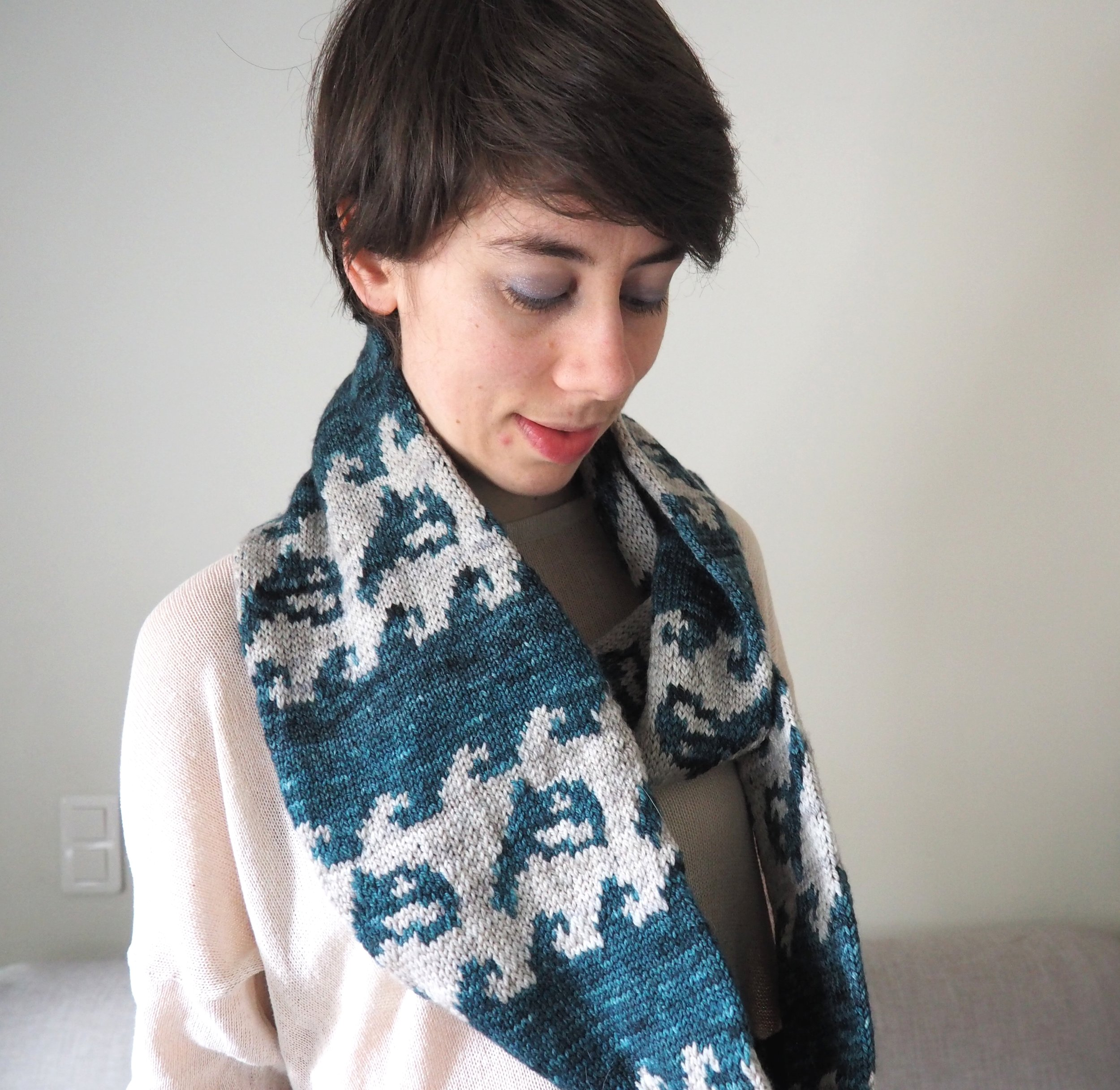 Orca Cowl - This cowl is worked in the round, sideways with a two-color stranded pattern that represents a whole orca society swimming across the ocean together. This versatile design is available in two sizes and when you wear it around your neck, it will tell the world just how strong your tribe is!