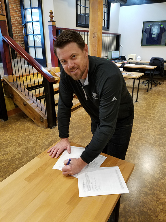 Devin signing Colvos'first project contract early this year.
