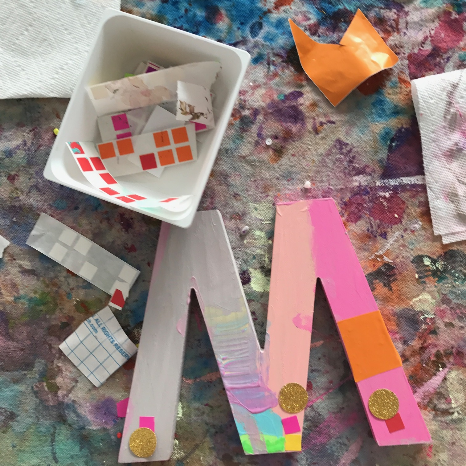 Adding stickers and color contact paper pieces