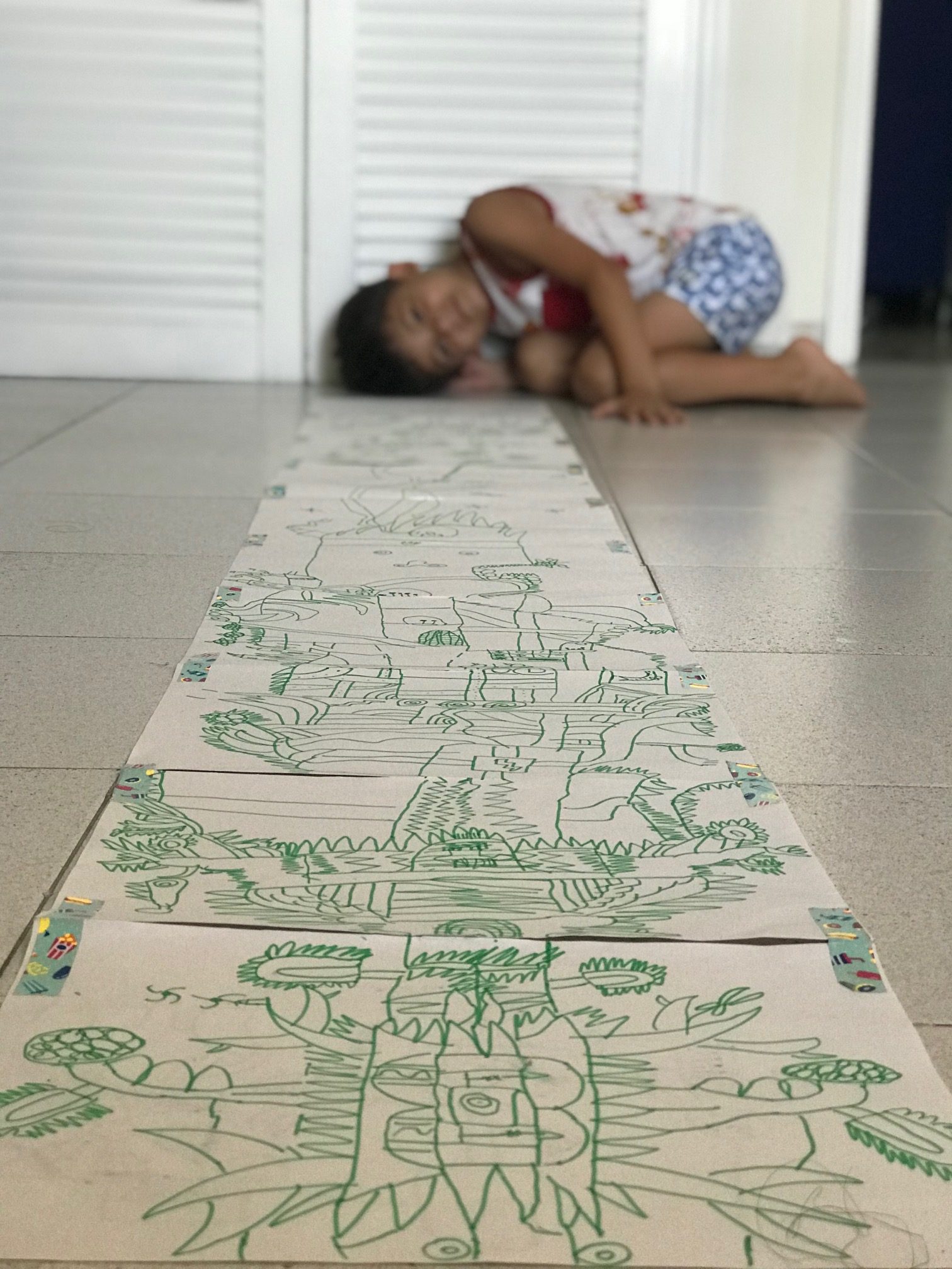 Martin (7) with a twice his size drawing he did while on our vacations in Colombia recently.