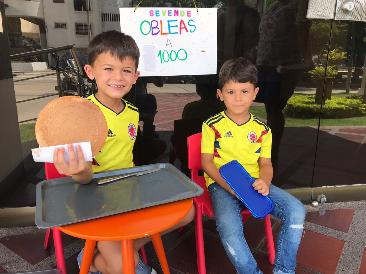 Martin & Manolo selling obleas for $1000 pesos outside of their Grandmas house in Barranquilla, Colombia.