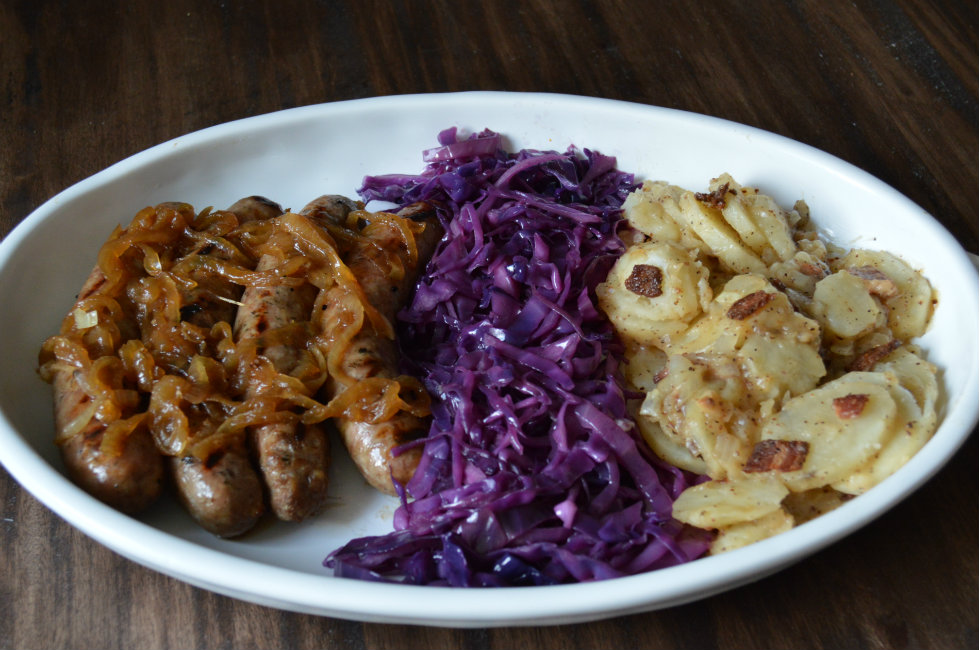 Smothered Onion Beer Bratwurst. We Paired this with a Kabinett Riesling! | CaretoPair.com