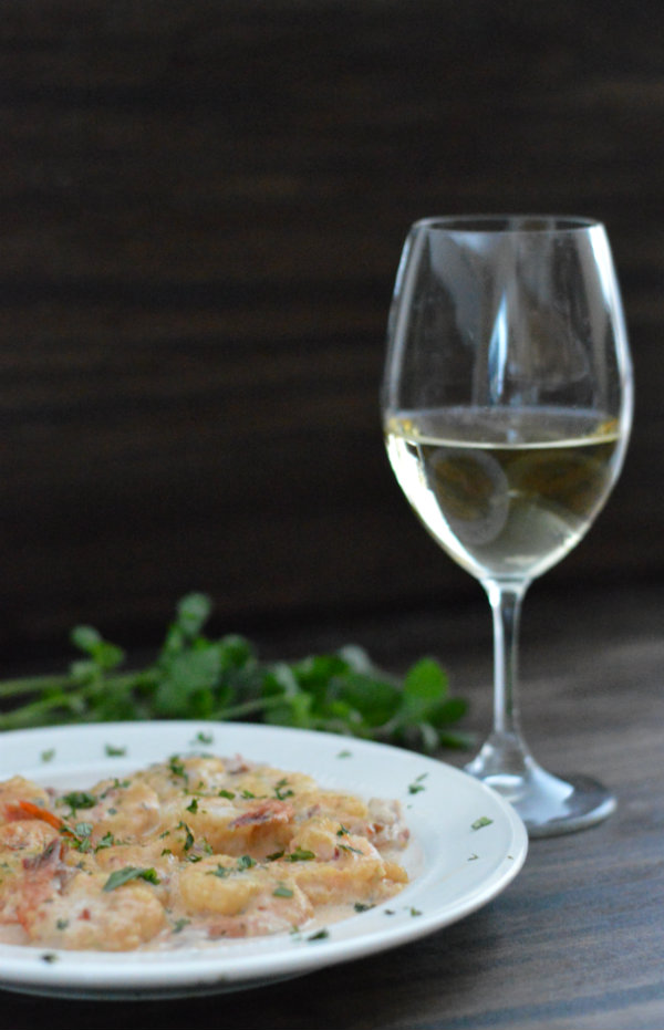 Chipotle Cream Shrimp Paired with Albarino. This easy meal gets cooked up in 10 minutes! Make it spicy...or not. Serve over Rice | CaretoPair.com