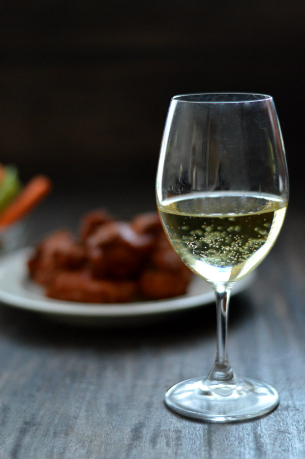 Chicken wings make a tough wine pairing, but some wines do work! Check out Dani's recommendation for pairing wine and spicy chicken wings together | CaretoPair.com