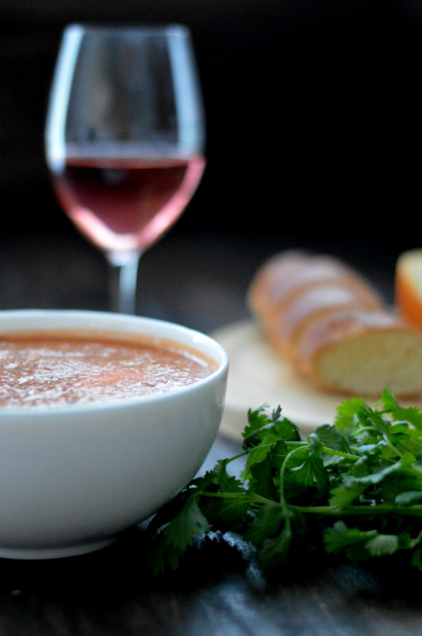 This homemade gazpacho is seriously the BEST I've ever had. Served with a glass of rosé wine and cheese plate, this makes an easy, relaxed summer meal |CaretoPair.com
