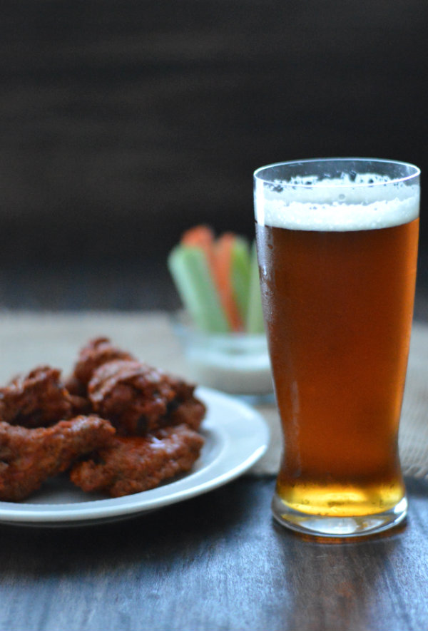 Here's a list of the best beers to pair with chicken wings! It may be an easy pairing, but some beers accentuate flavors more than others! via CaretoPair.com