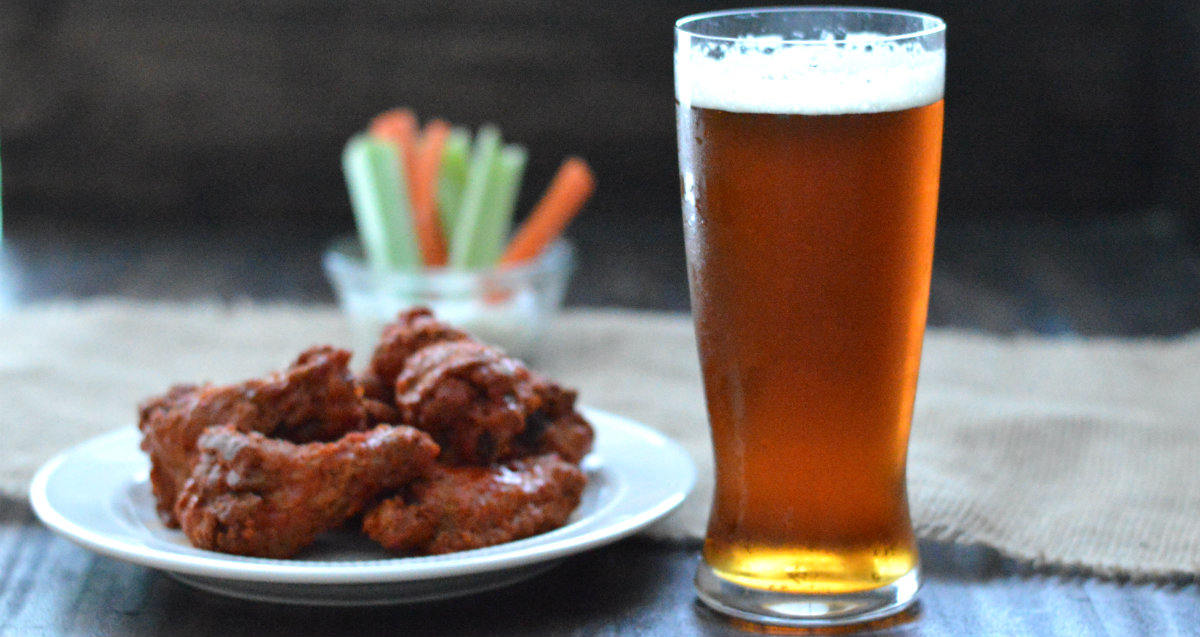 The best list of beers to pair with chicken wings, whether you want them to heat things up or cool things down | CaretoPair.com