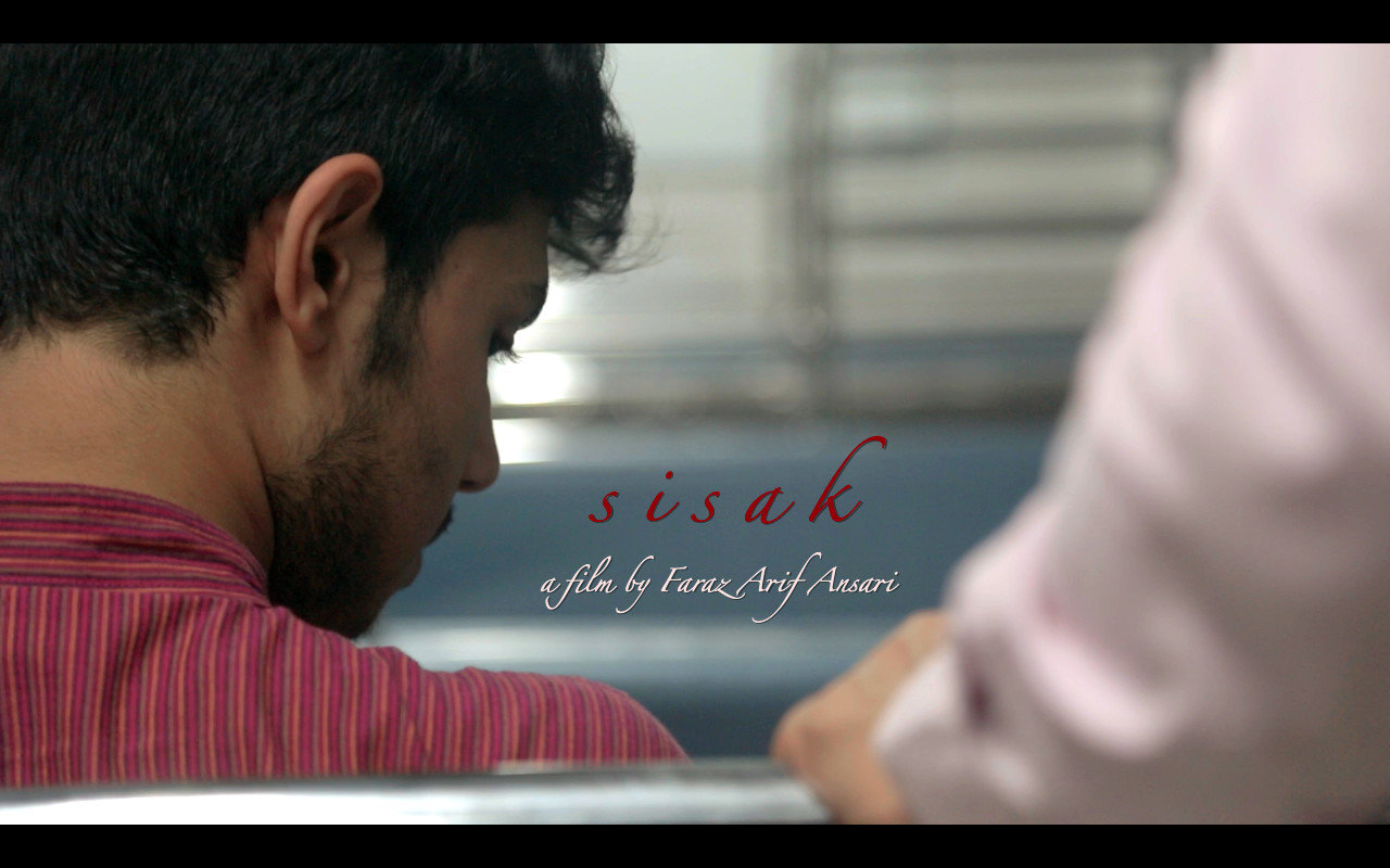 Sisak - Directed by Faraz Arif AnsariA first-of-its-kind silent LGBTQ film in India, Sisak makes waves before the visuals of this short hit the shore. Set in the fast-paced environs of the usually bustling Mumbai local train system, it details a romance that develops slowly and intoxicatingly, nestled in the silences and quiet comforts of the end-of-day train journeys.