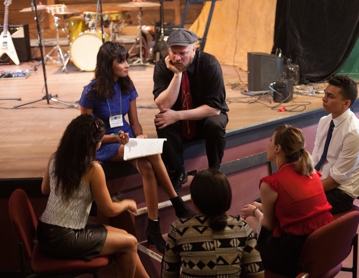 A team at a Face The Music leadership program event figures it out