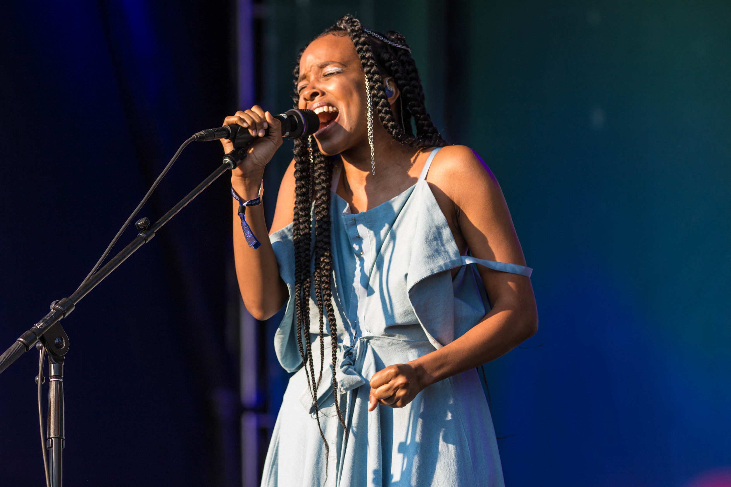 Jamila Woods singing in the sunshine