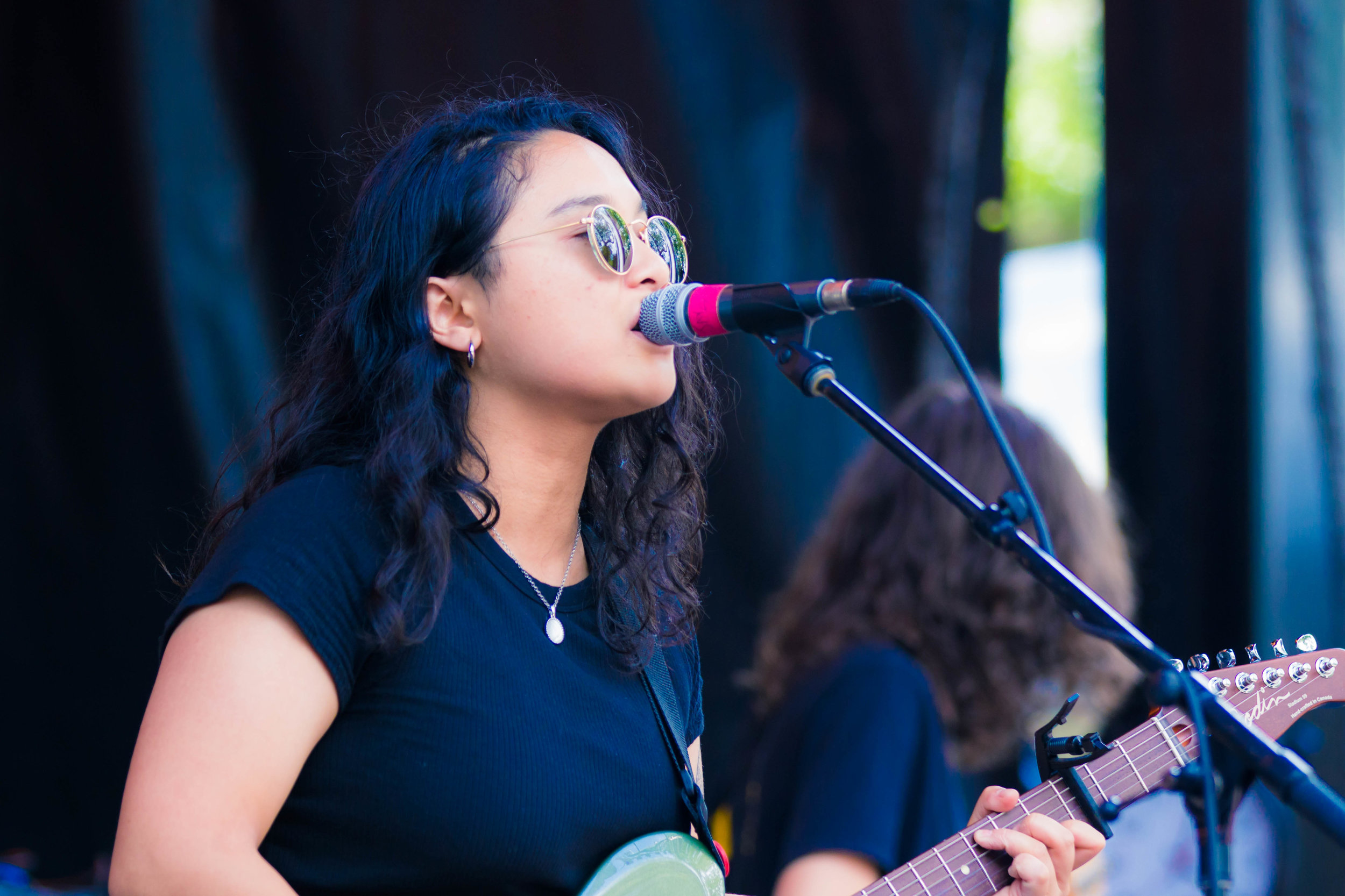Jay Som performing at the Blue Stage