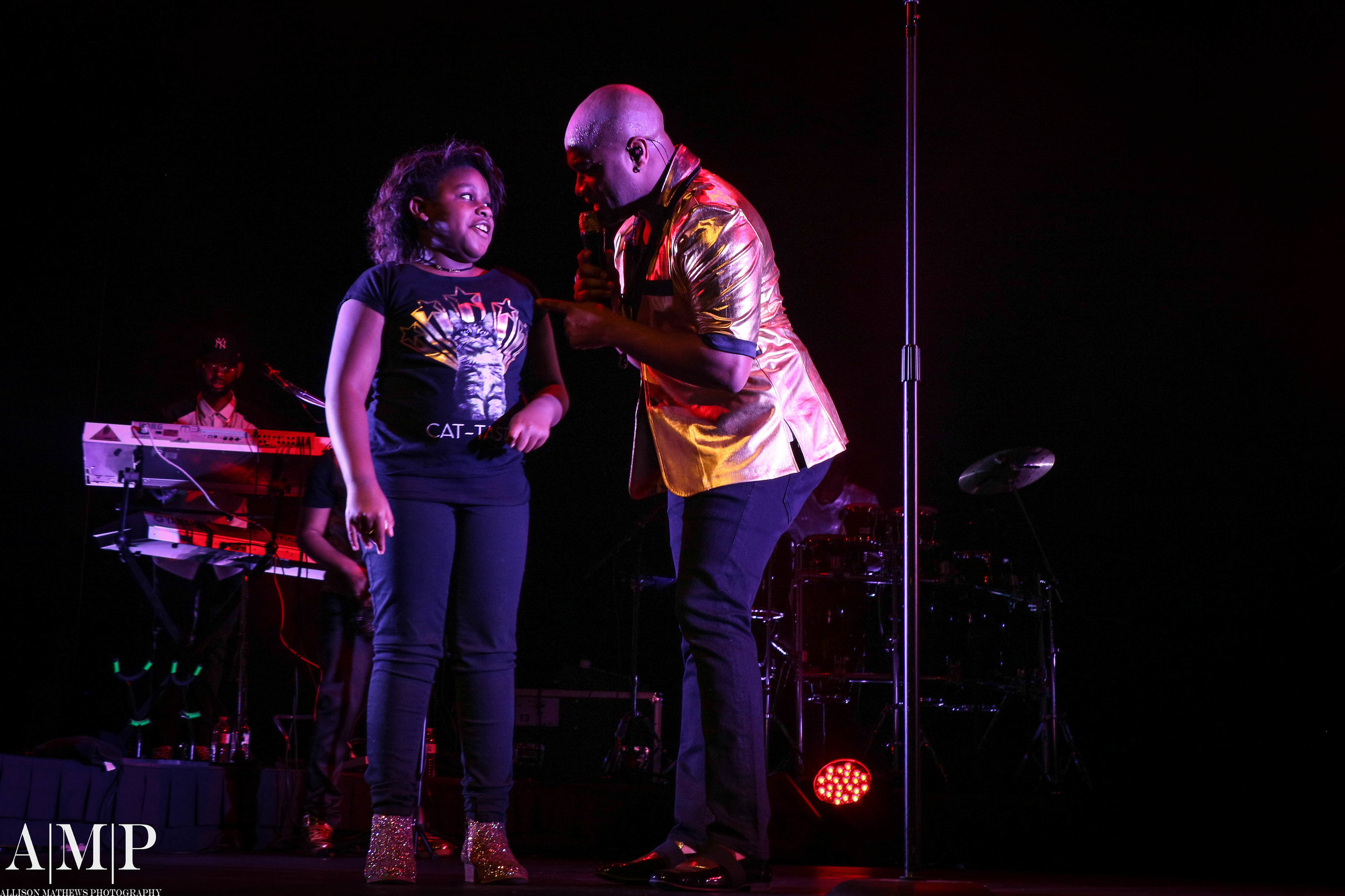 """A """"Golden Moment"""" on stage with his adorable daughter during his Prince Tribute."""
