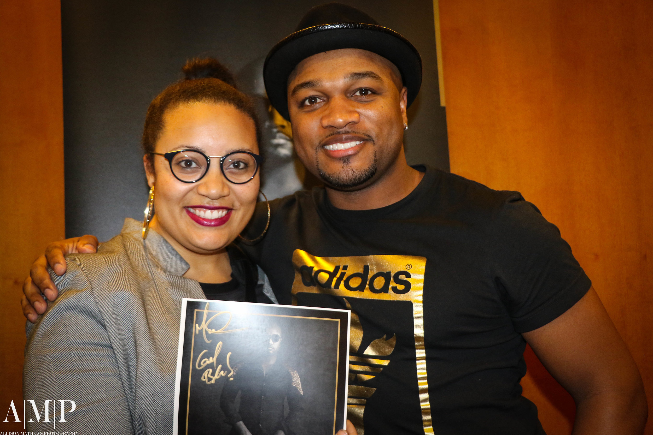 Photographer Dr. Allison Mathews takes a candid pic with Marcus Anderson!