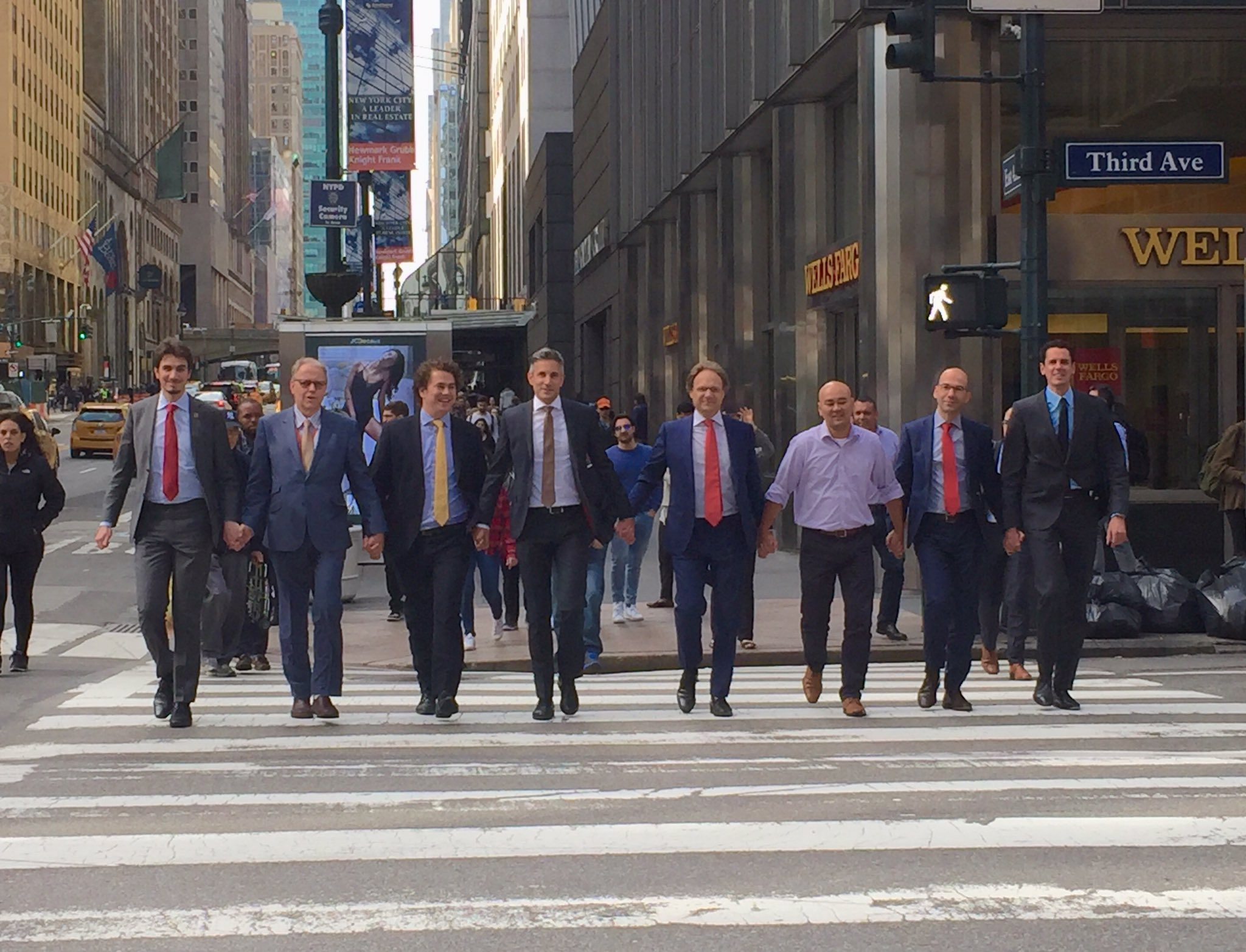 Men holding hands in New York City to show their support for the LGBTQ2 community.