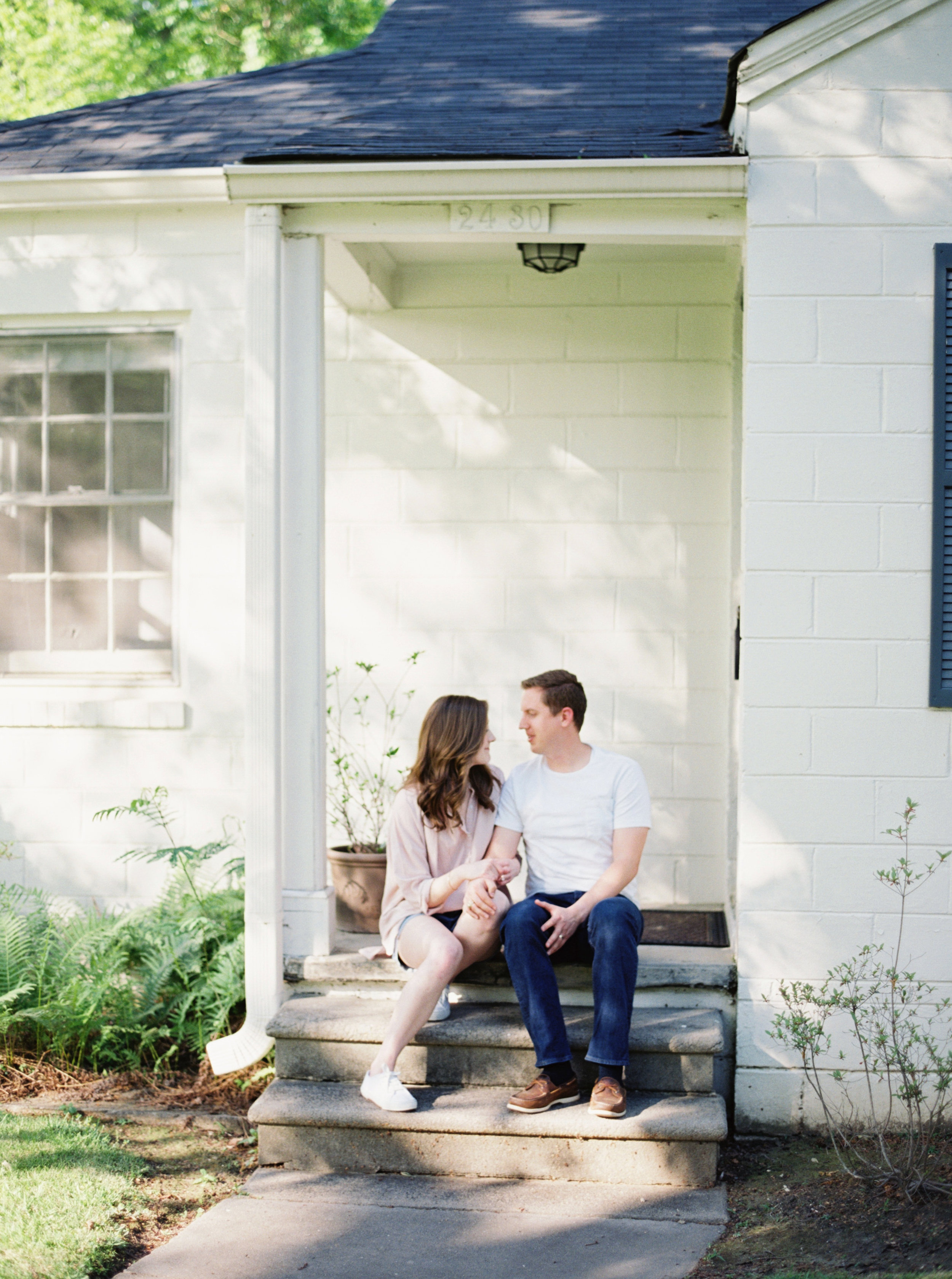 Anniversary images captured in the home in an authentic, everyday, intimate and lifestyle way. Anniversary photo sessions make for one of the best anniversary or even wedding gifts for your wife. It's a sweet way of being able to preserve your first memories of everyday life together. This session was captured by Meghan Murphy, a fine art film photographer based out of Birmingham, Alabama. This anniversary photo session took place at the couple's home in Mountain Brook Village. You can find the couple washing dishes together, cooking together, praying together, sharing sweet intimate moments and visiting their favorite ice cream shop (Mountain Brook Creamery) that's within walking distance from their house.