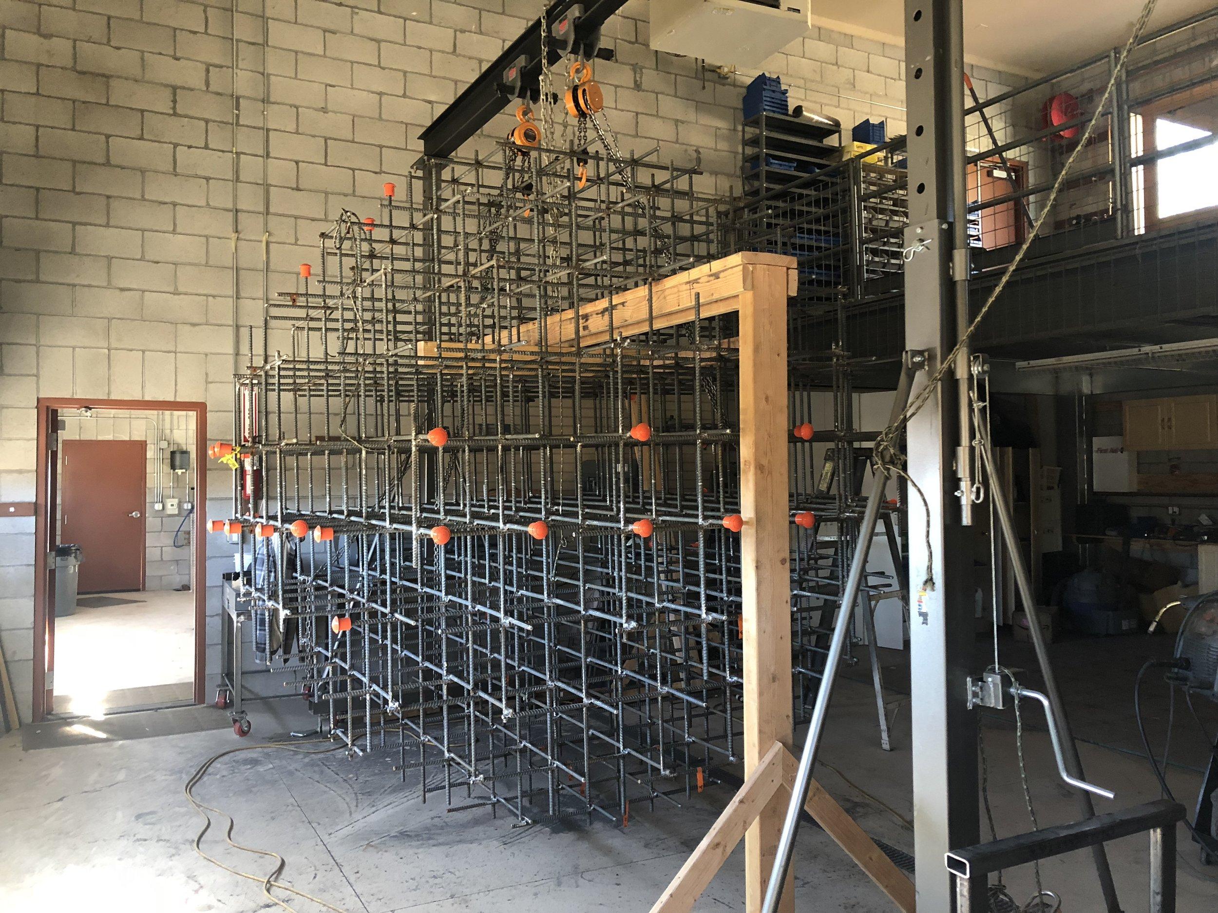 The artist welding the Rebar Sphere at Buffalo Creek art Center workshops