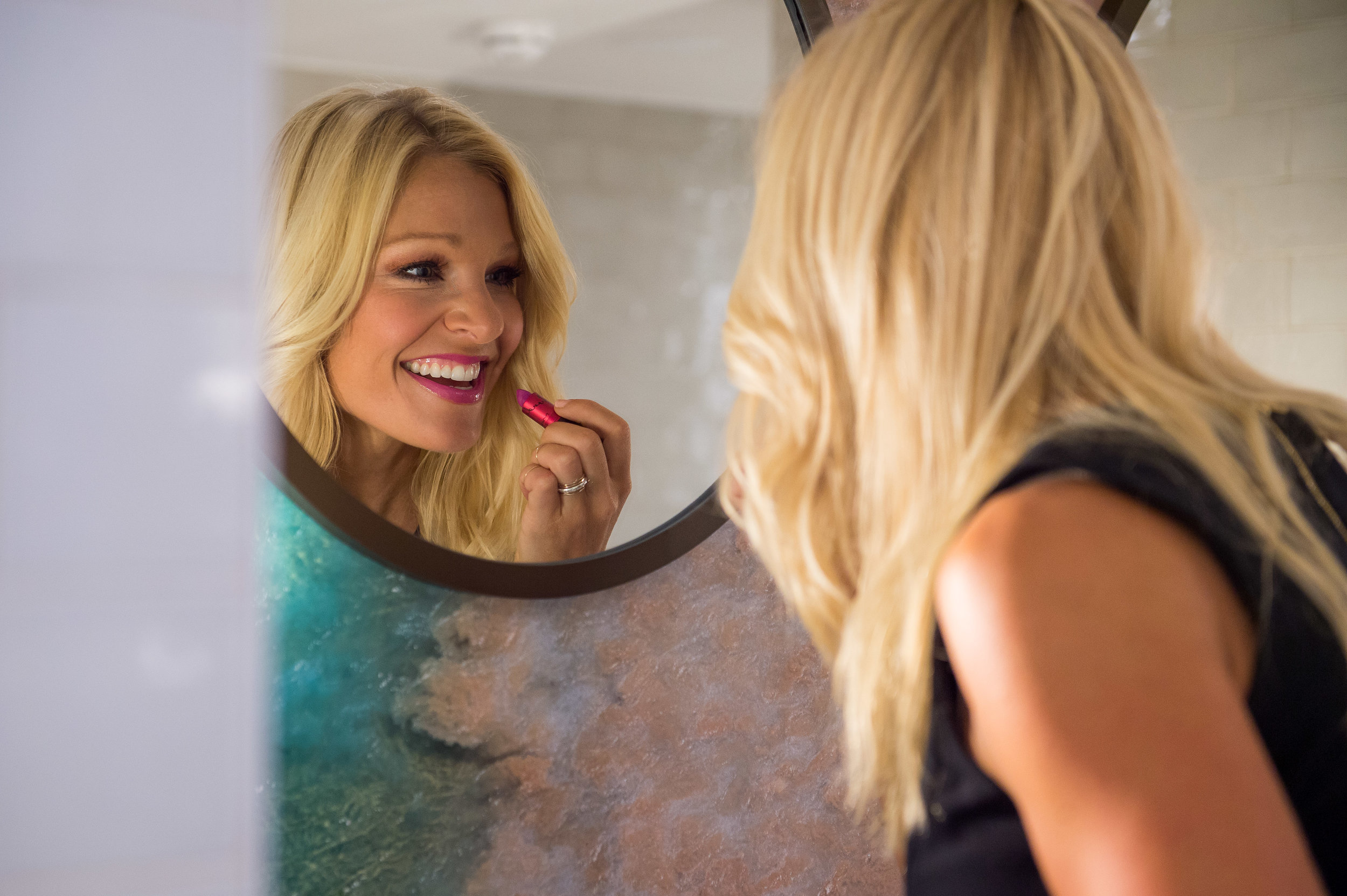 Anna Kooiman Putting On New MAC Viva Glam Lipstick