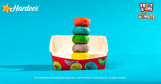 Taste the loopy rainbow of Froot Loops Mini Donuts now at Hardee's. It's like gold, but in donut form. -