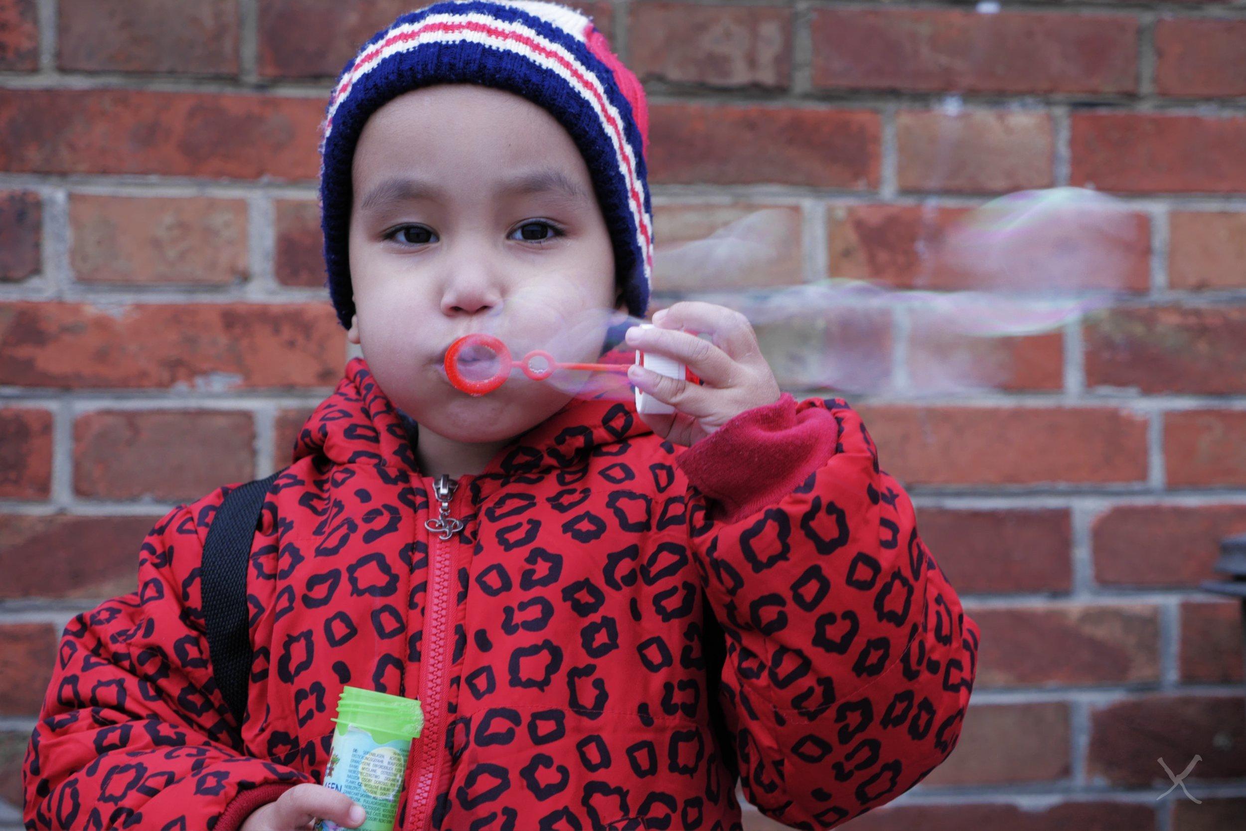 kidblowingbubbles.jpg