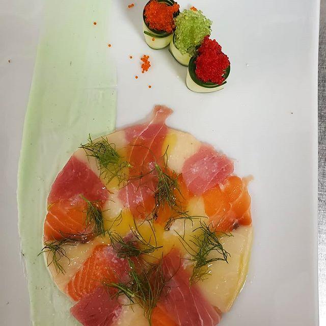 Mosaic of seafood carpaccio. Trio of tobiko. Wasabi emulsion