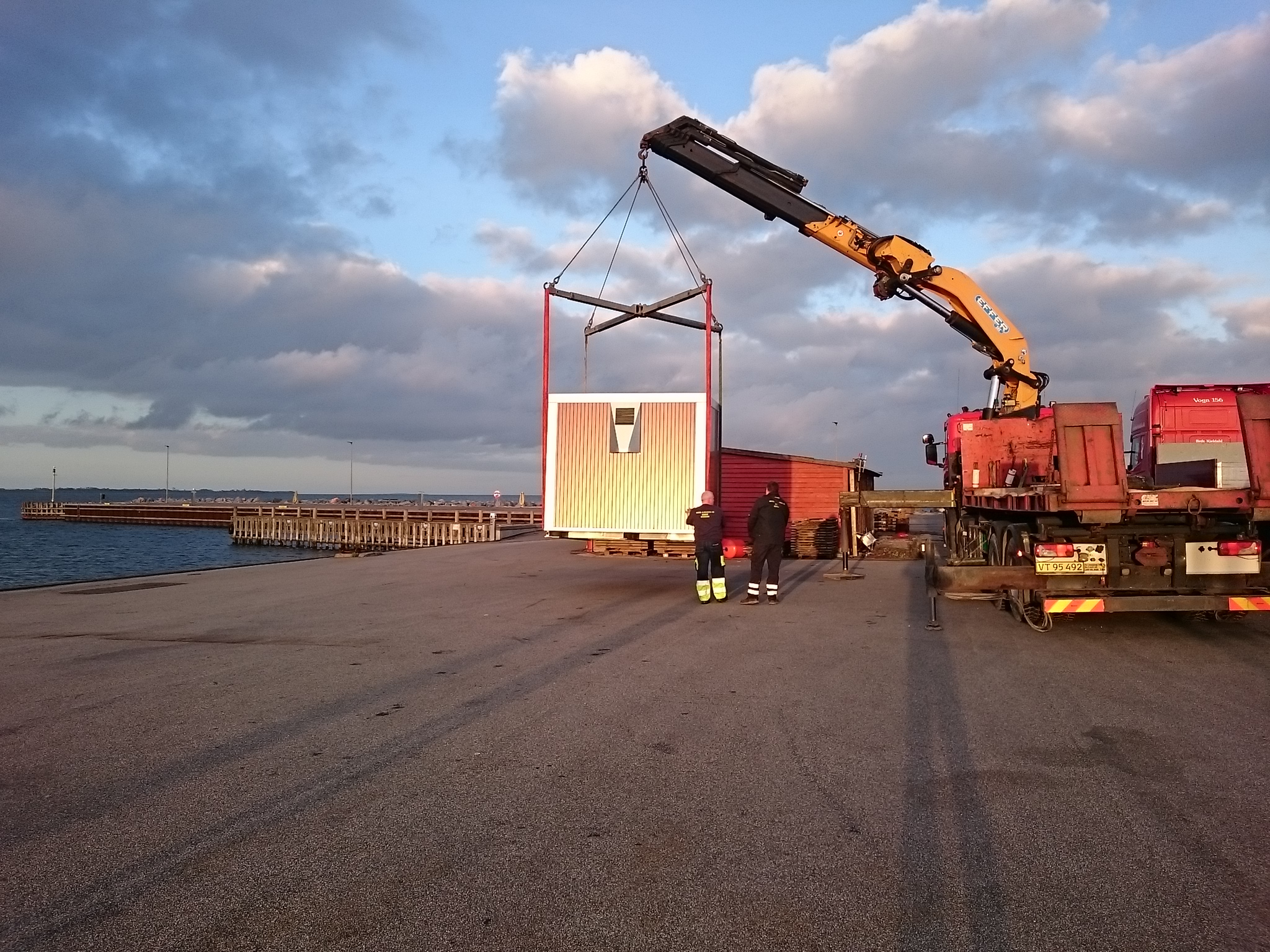 A cabin arrives at Ballen marina, Samso, for housing a battery system (Lithium Balance 240 kWh)