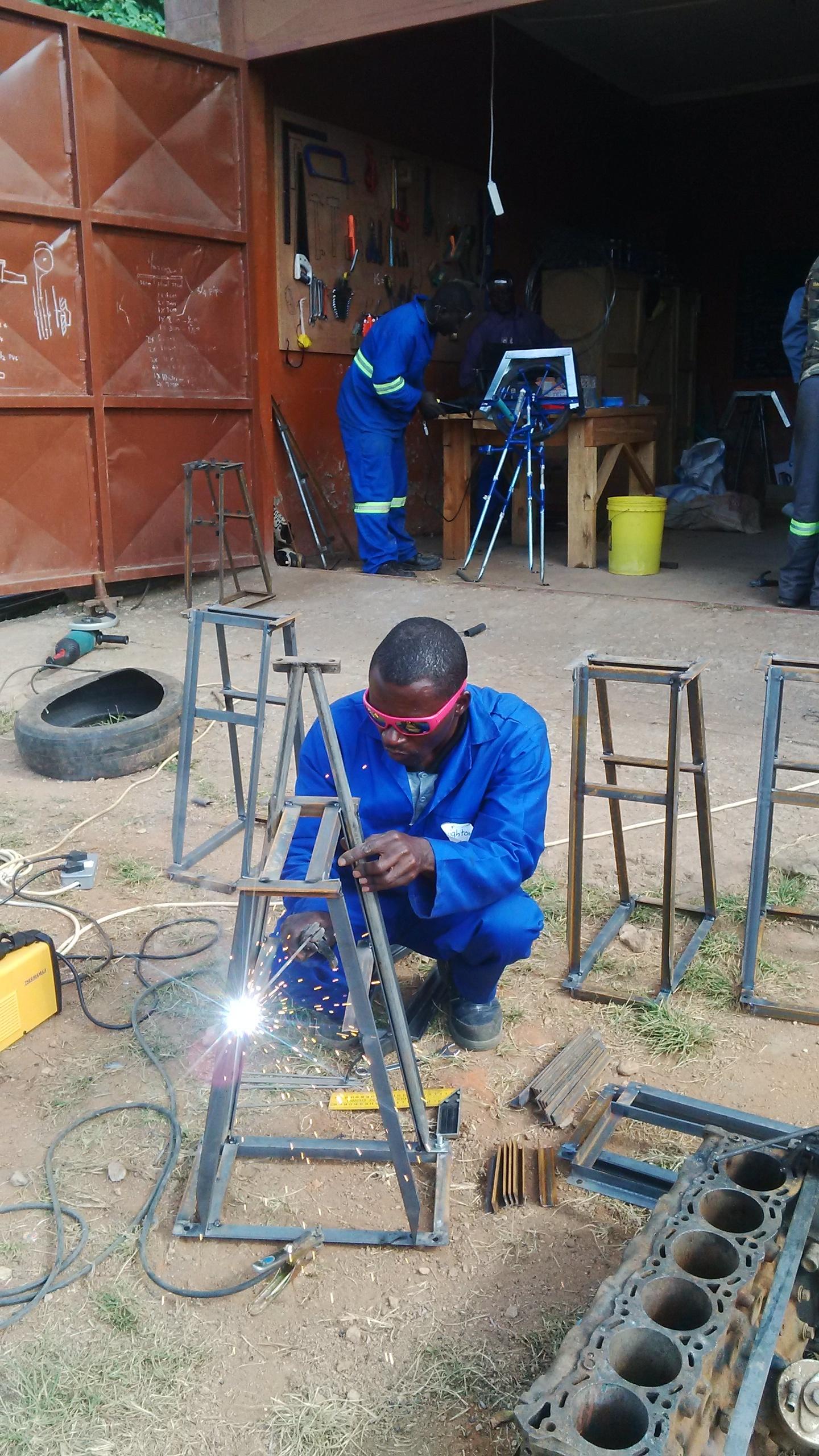 Brighton at his workshop in Kasungu, Malawi, 2017.