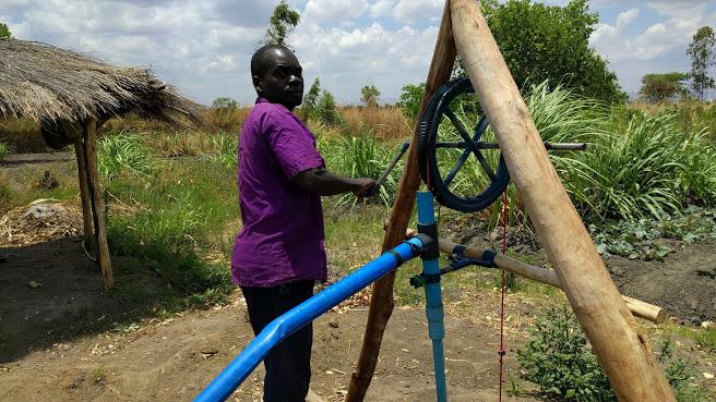 Kambale Makiyi with his irrigation pump.