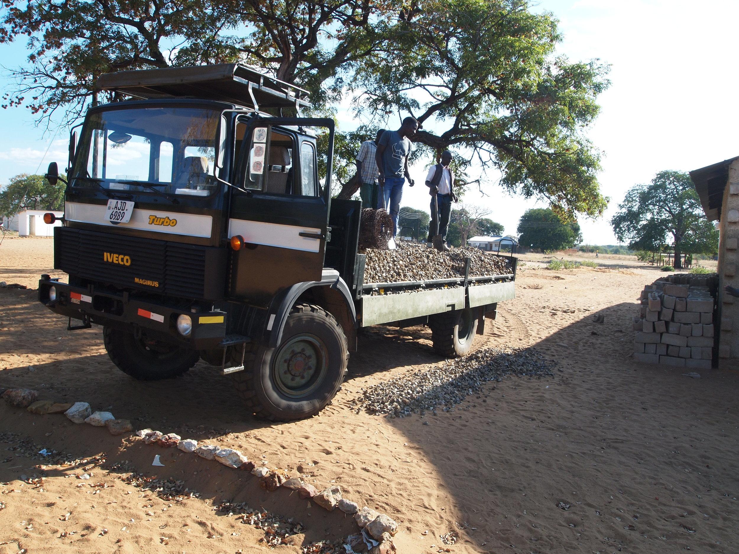 Delivering stones for a building foundation