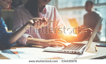 stock-photo-creative-team-working-on-a-project-in-loft-office-two-women-discussing-marketing-plan-laptop-and-534030976.jpg