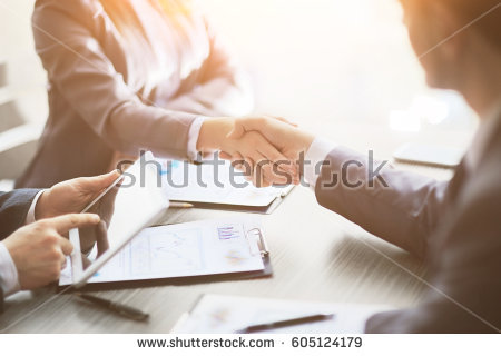 stock-photo-business-people-shaking-hands-finishing-up-meeting-605124179.jpg