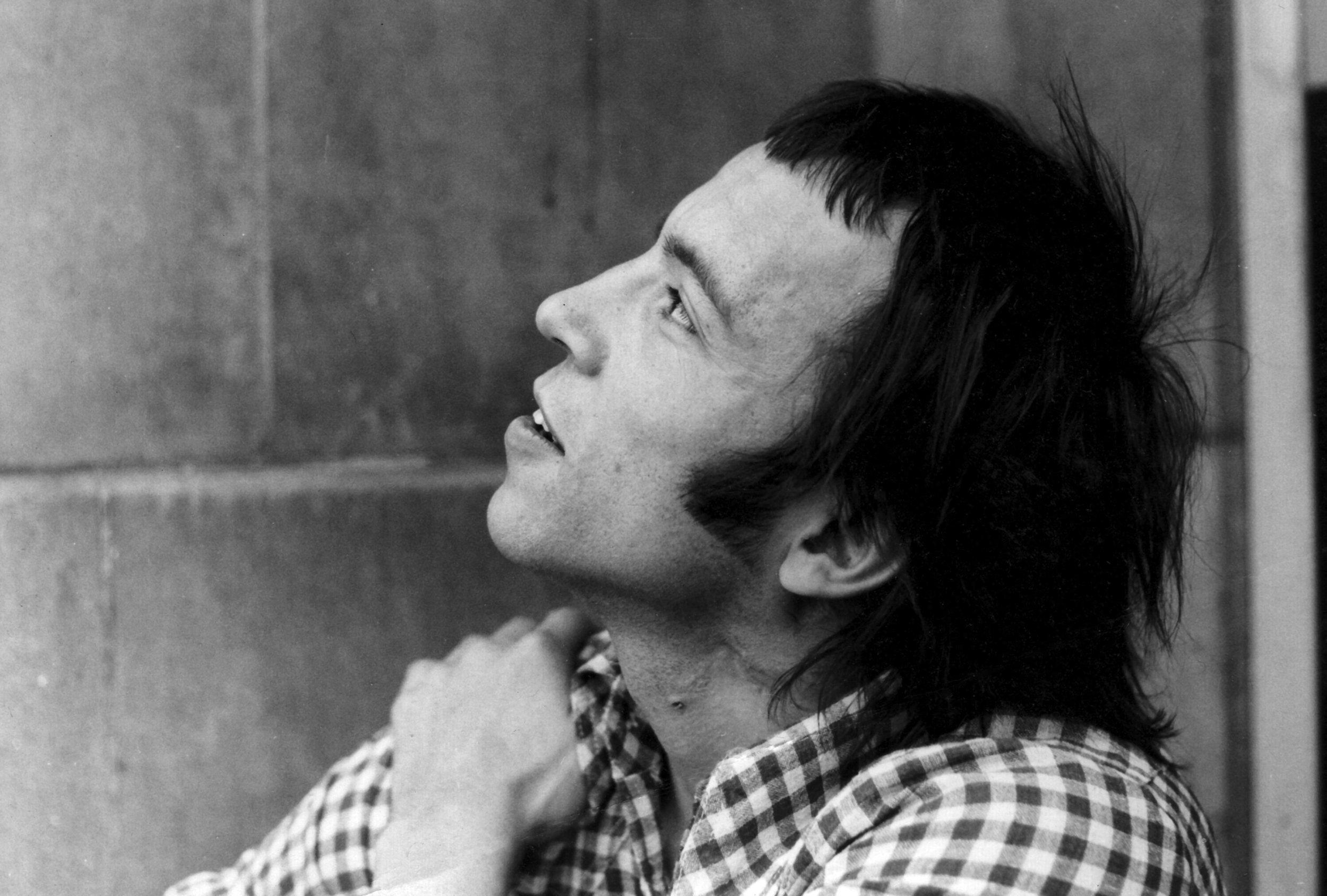David Widgery sitting in a doorway in Soho in 1973. (Image: Michael Gray)