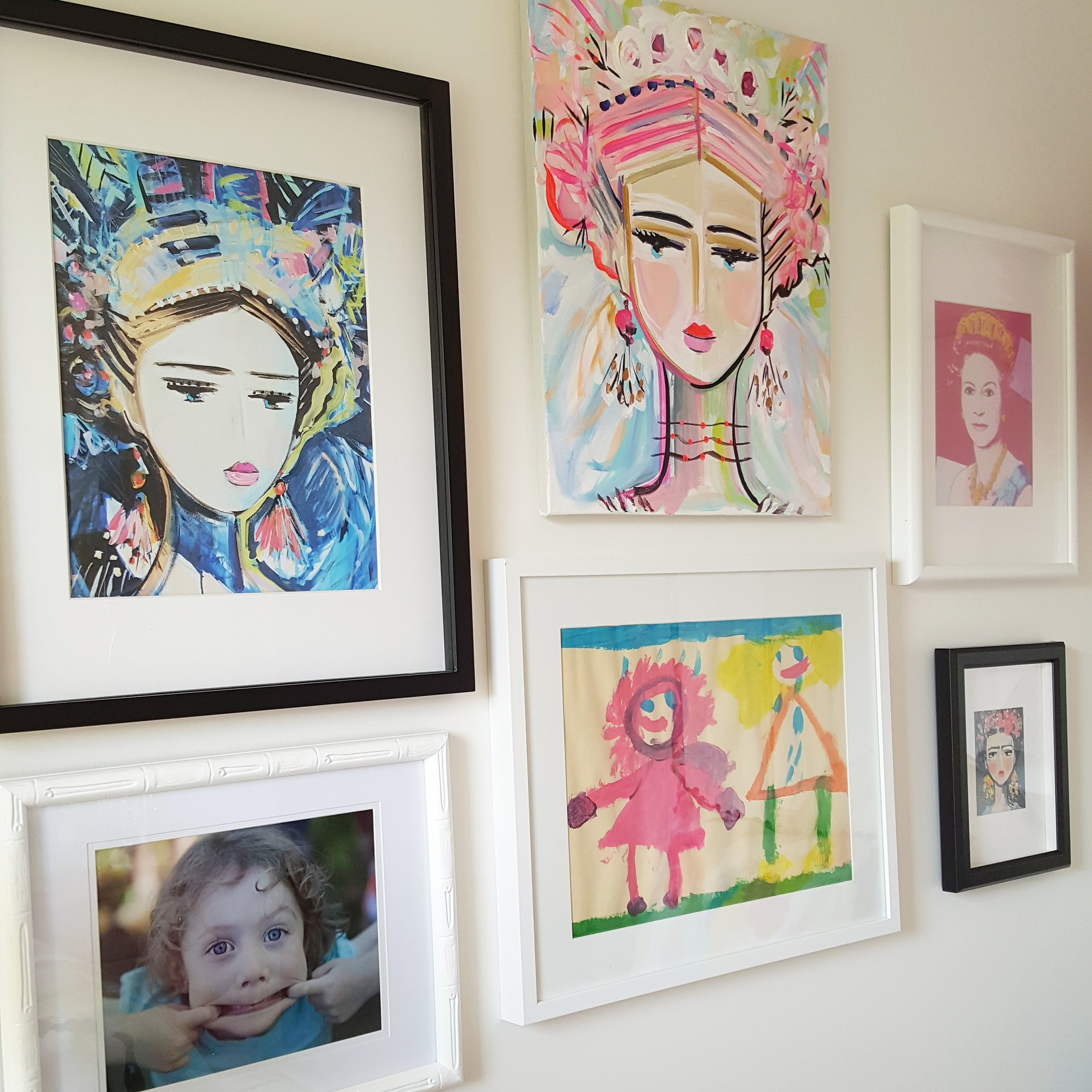 "Lily's ""Wall of Girls"" featuring paintings and prints by artists Marin devine & lily"