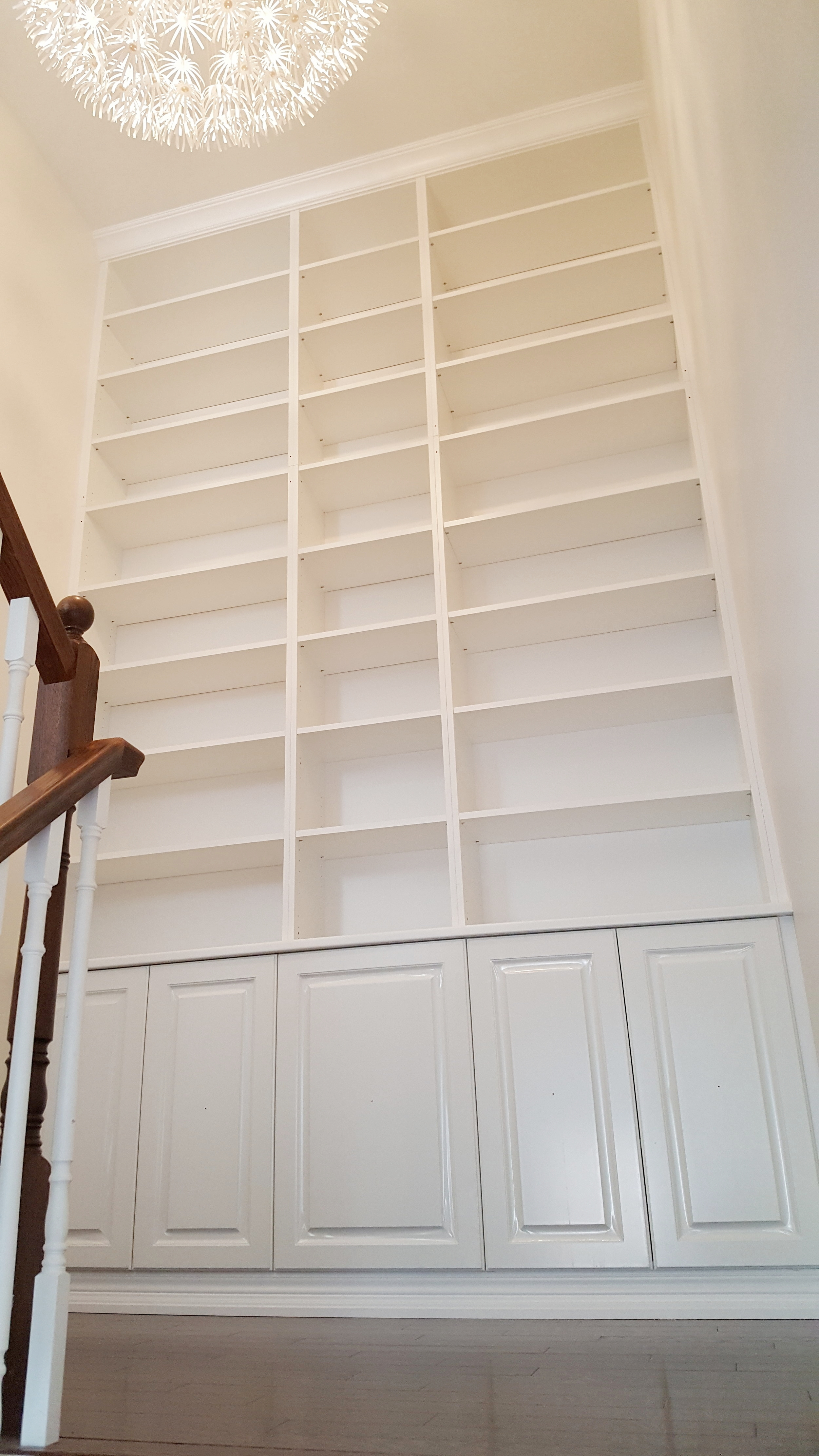Library wall built from IKEa Billy Bookcases, Ikea Counter and home depot in-stock upper kitchen cabinets
