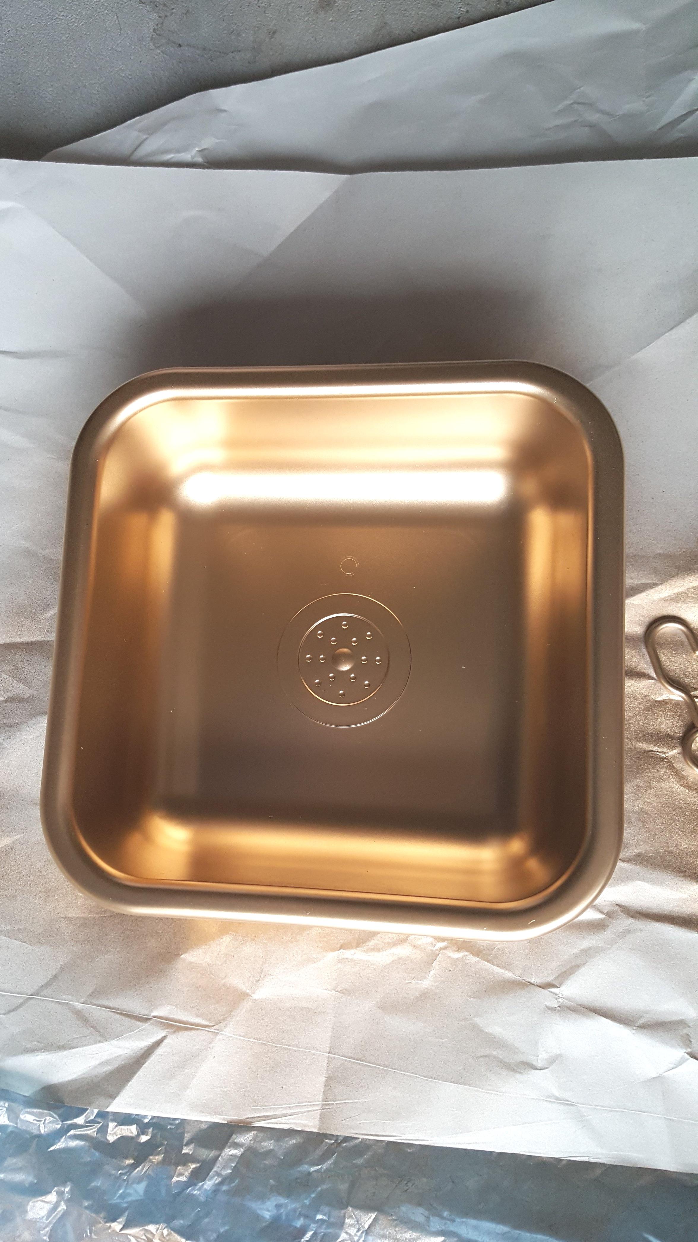 Spraying the sink gold