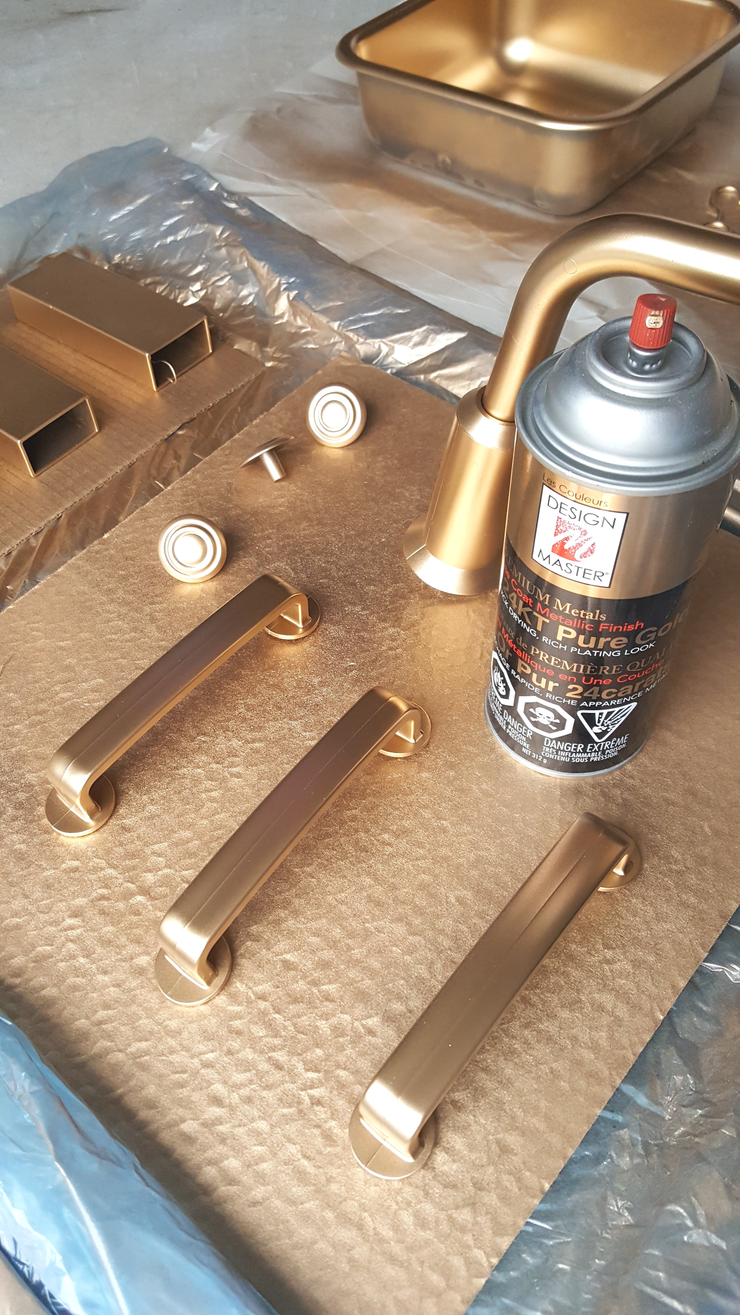 Spraying the hardware with gold spray paint