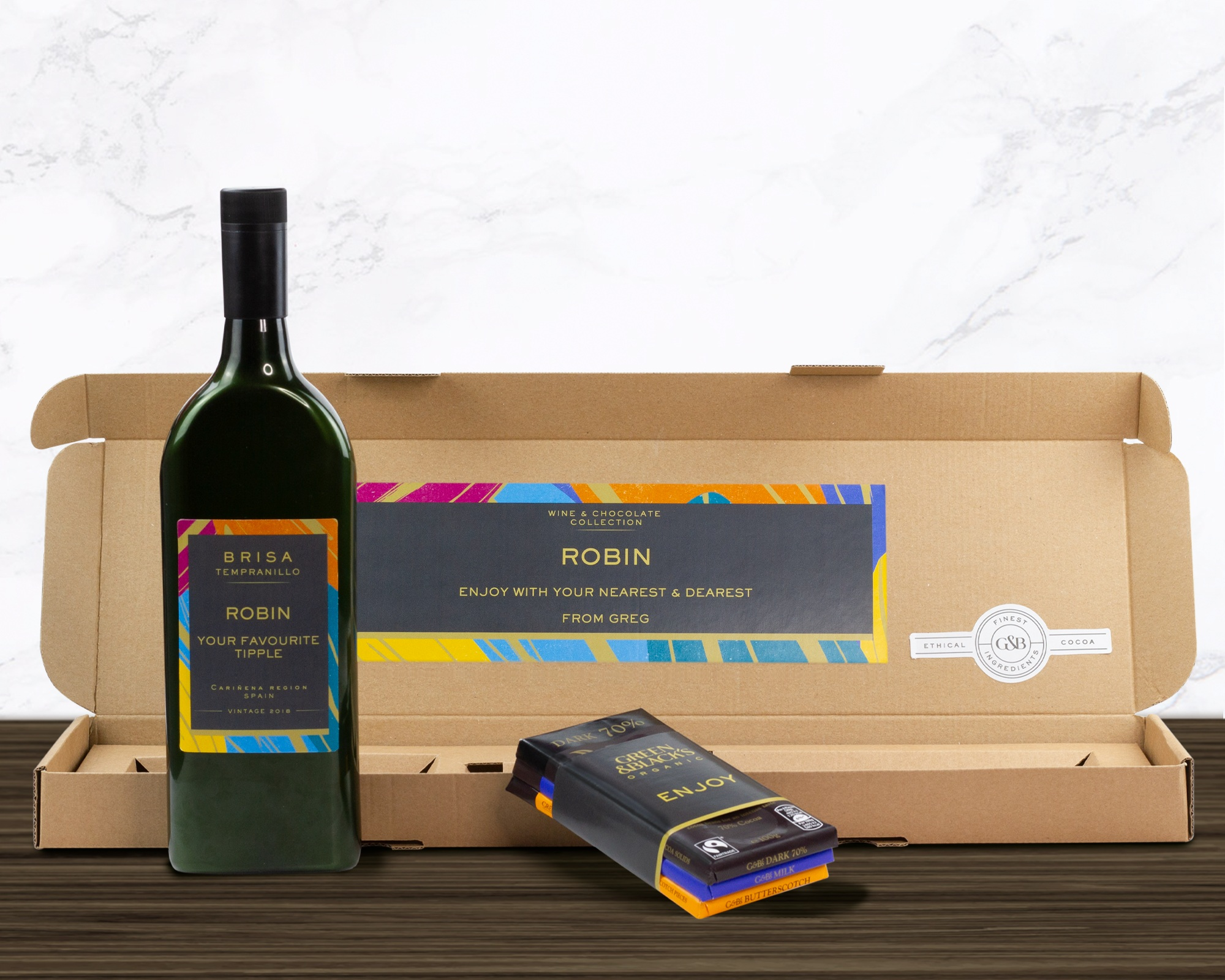 The Wine & Chocolate Collection - Create indulgent moments in the home with the next generation of personalised gifting, featuring Brisa Tempranillo Letterbox Wine® and Green & Black's Milk, Butterscotch and 70% Dark luxury chocolate bars.