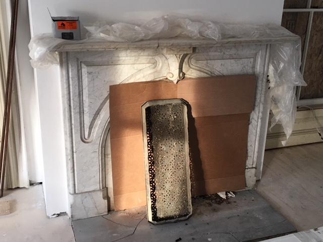 Ornate marble fireplace Pickering House Inn