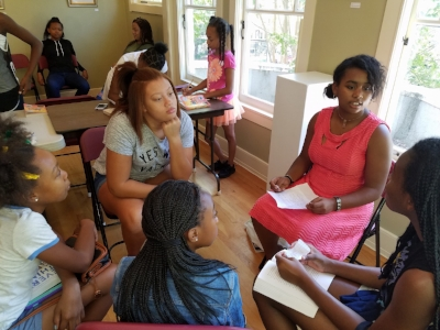Sacramento chapter Summer Girls Book Club in deep discussion